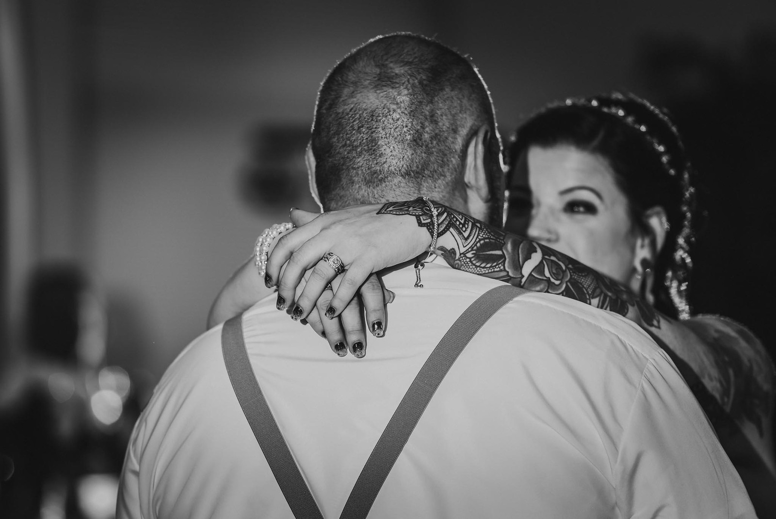 Black and white photo of bride and groom during first dance with focus on wedding rings at Ceruti's Catering in Fort Wayne, Indiana