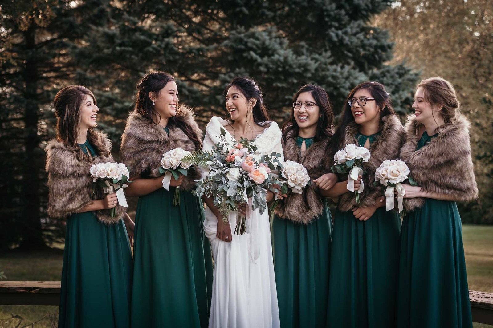 Bride laughing with bridesmaids in fall wedding in Fort Wayne, Indiana by Kasey Wallace Photography