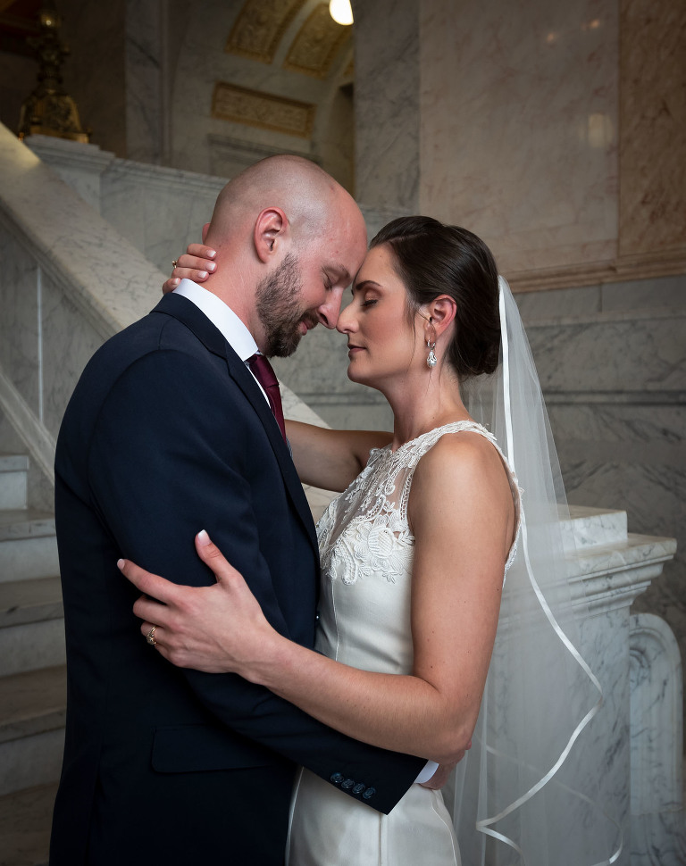 Bride and groom embracing, Allen County Courthouse Fort Wayne Indiana wedding photography, Kasey Wallace Photography