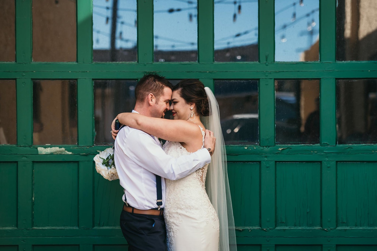 Bride and groom embracing during outdoor portraits in Auburn, Indiana by Kasey Wallace Photography