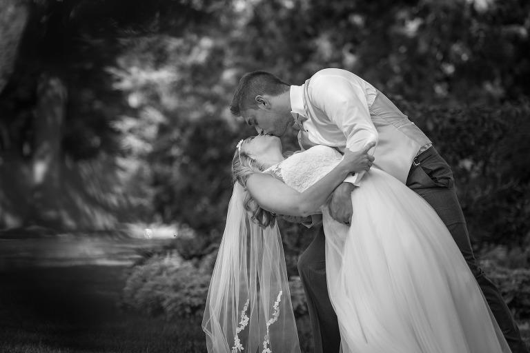 Fort Wayne Wedding Photography, Fort Wayne Bride, Bride and Groom, dip kiss, Groom kissing Bride, wedding gown, wedding dress, Lakeside Rosegardens, Fort Wayne Indiana, black and white photography, www.kaseywallacephoto.com