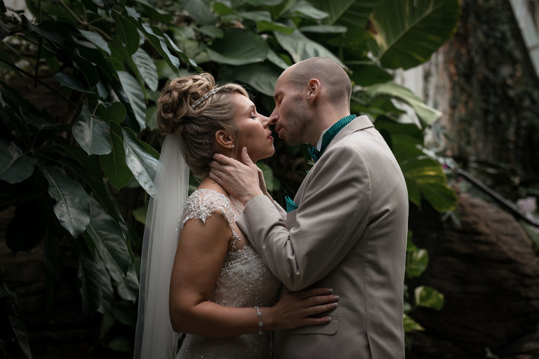 Bride and groom embracing and kissing, Botanical Conservatory Fort Wayne Indiana wedding photography, Kasey Wallace Photography