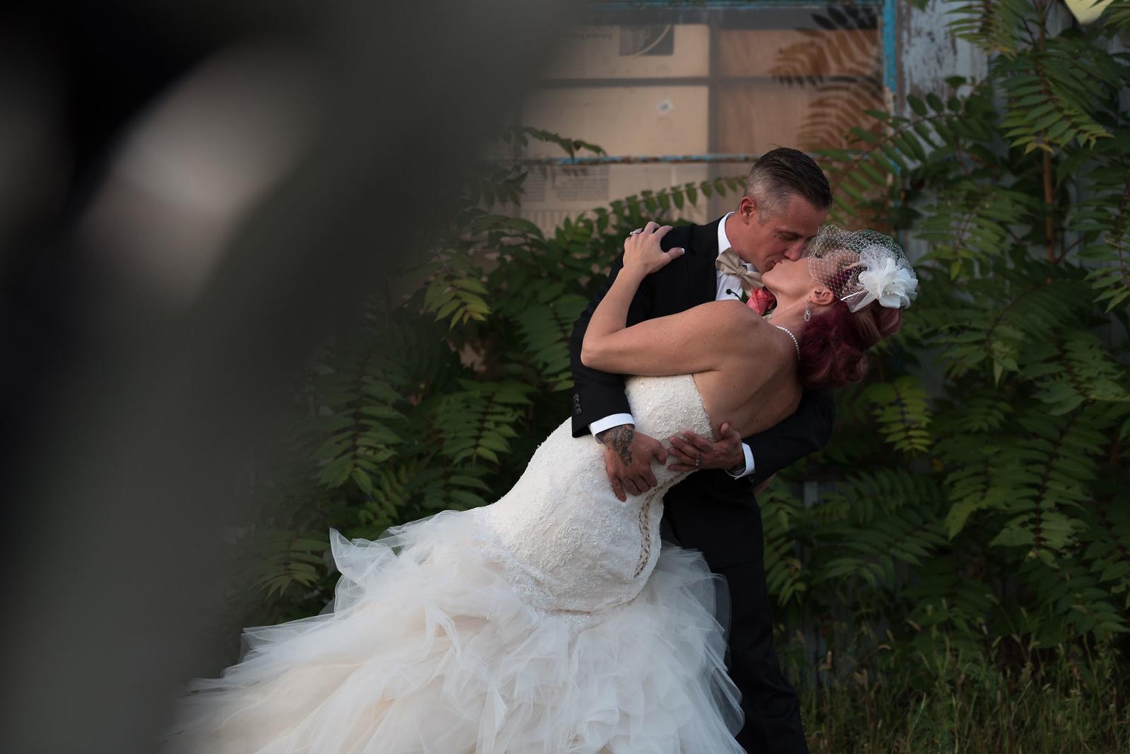 Auburn Wedding Photographer, bride and groom kissing, vintage wedding, couture wedding dress, tattooed bride and groom, Auburn Indiana, Kasey Wallace Photography - www.kaseywallacephoto.com