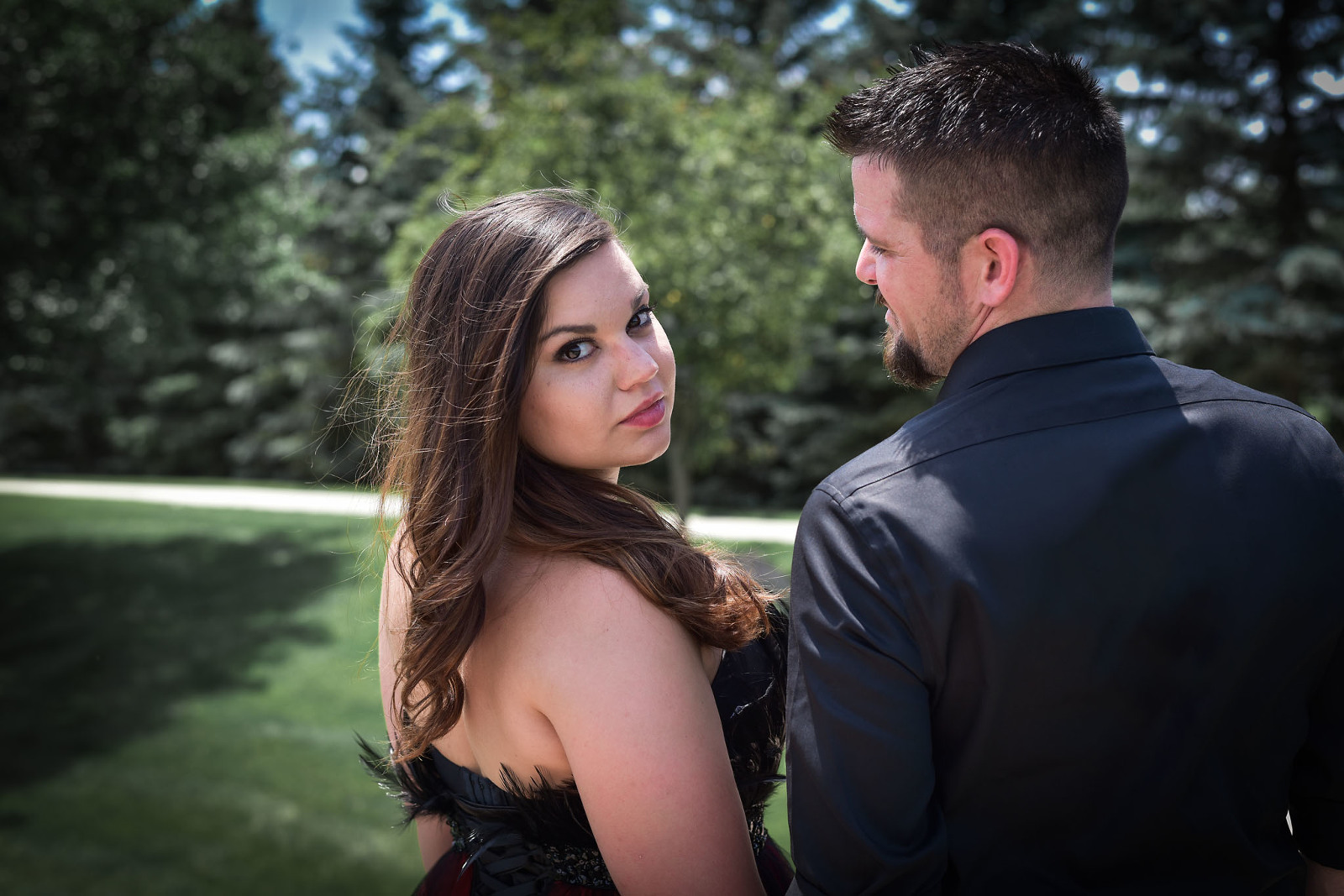 Couple embracing in formal wear during outdoor engagement session in Auburn, Indiana by Kasey Wallace Photography