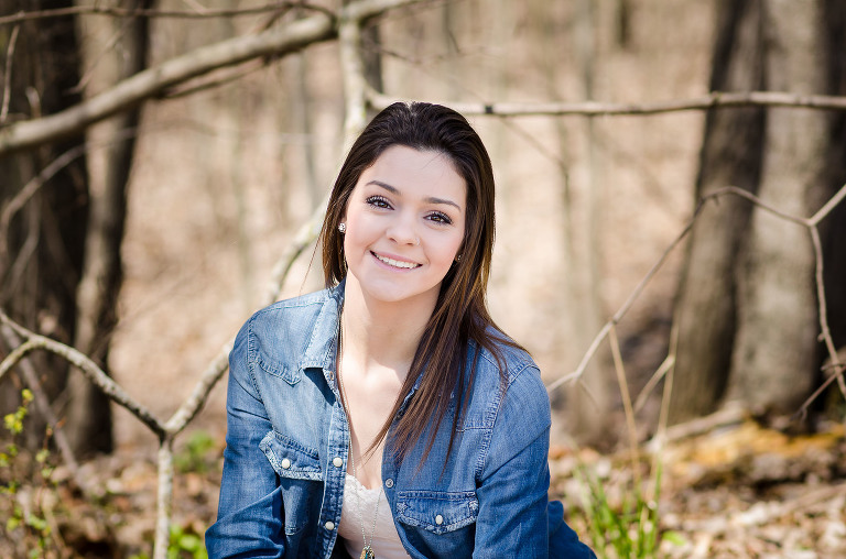 Brunette teenage girl during outdoor high school senior portraits session at Bridgwater Golf Course in Auburn, Indiana, by Kasey Wallace Photography