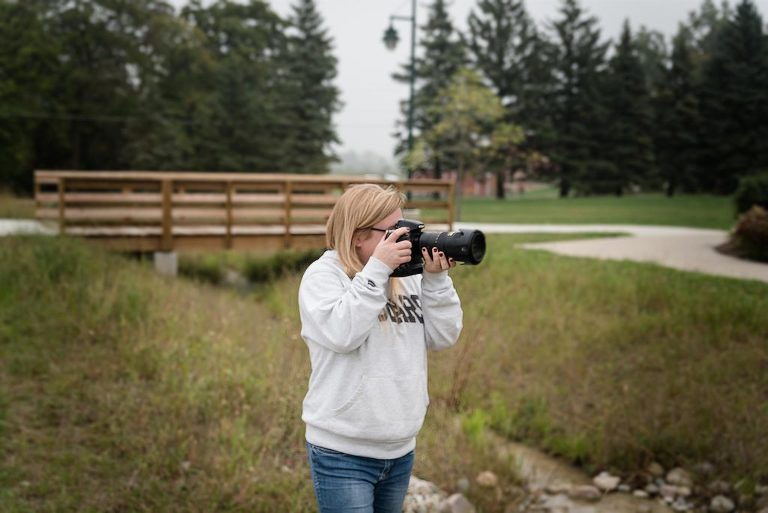 Kasey Wallace of Kasey Wallace Photography, photographing a family at Salomon Farm Park in Fort Wayne, Indiana