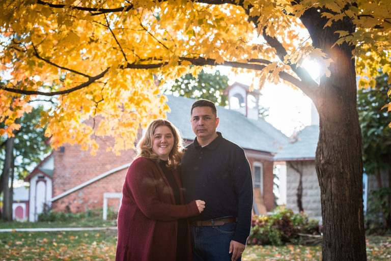 Family standing in park during outdoor family photography session in the fall at Salomon Farm Park in Fort Wayne, Indiana