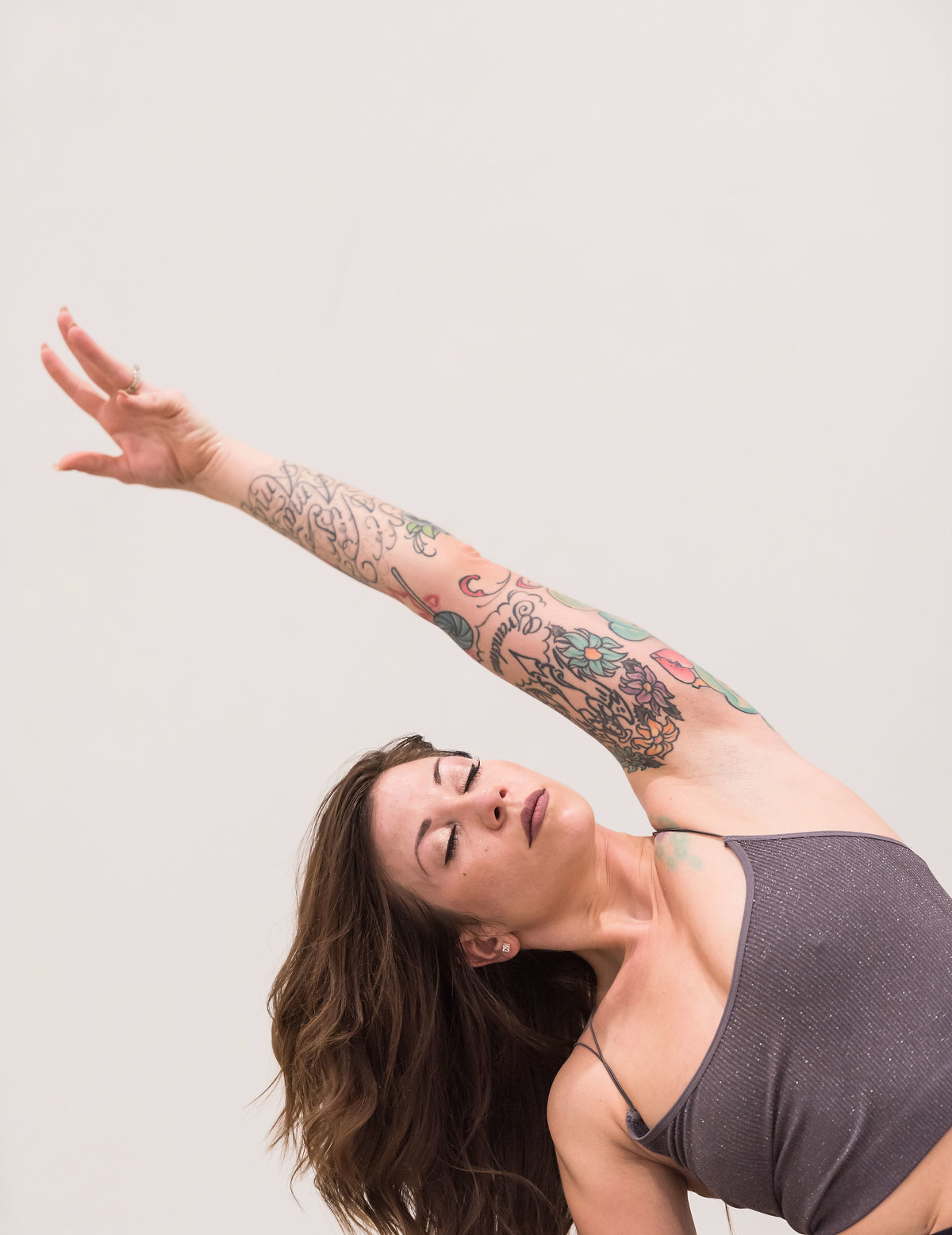 Brunette woman stretching in yoga pose during personal branding session at Fusion Yoga in Fort Wayne, Indiana