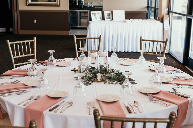 decorated tables at reception of intimate country club wedding