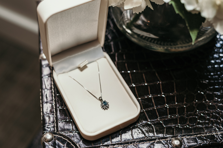 close up of family heirloom necklace bride wears at intimate country club wedding