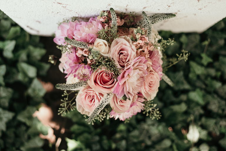 close up of fresh roses and other flowers in romantic bridal bouquet