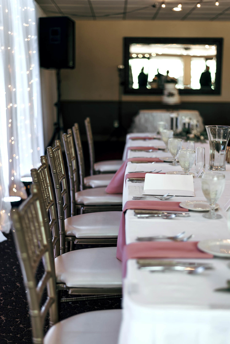 details of bridal party dinner placement at wedding reception