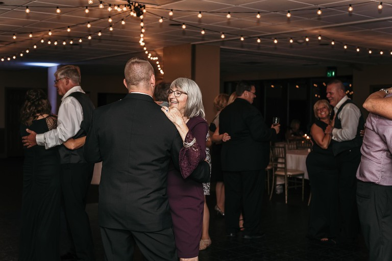 groom dances with grandmother at wedding reception