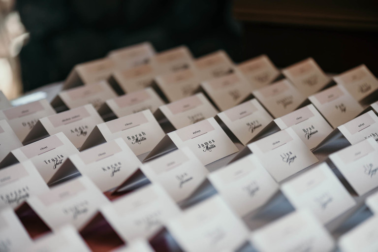 close up of name tags for reception seating at intimate country club wedding