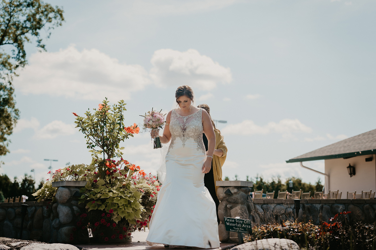 bride approaches groom outside during First Look at their intimate country club wedding
