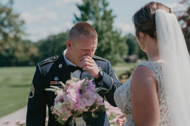 groom cries as he sees his bride during First Look at their intimate country club wedding
