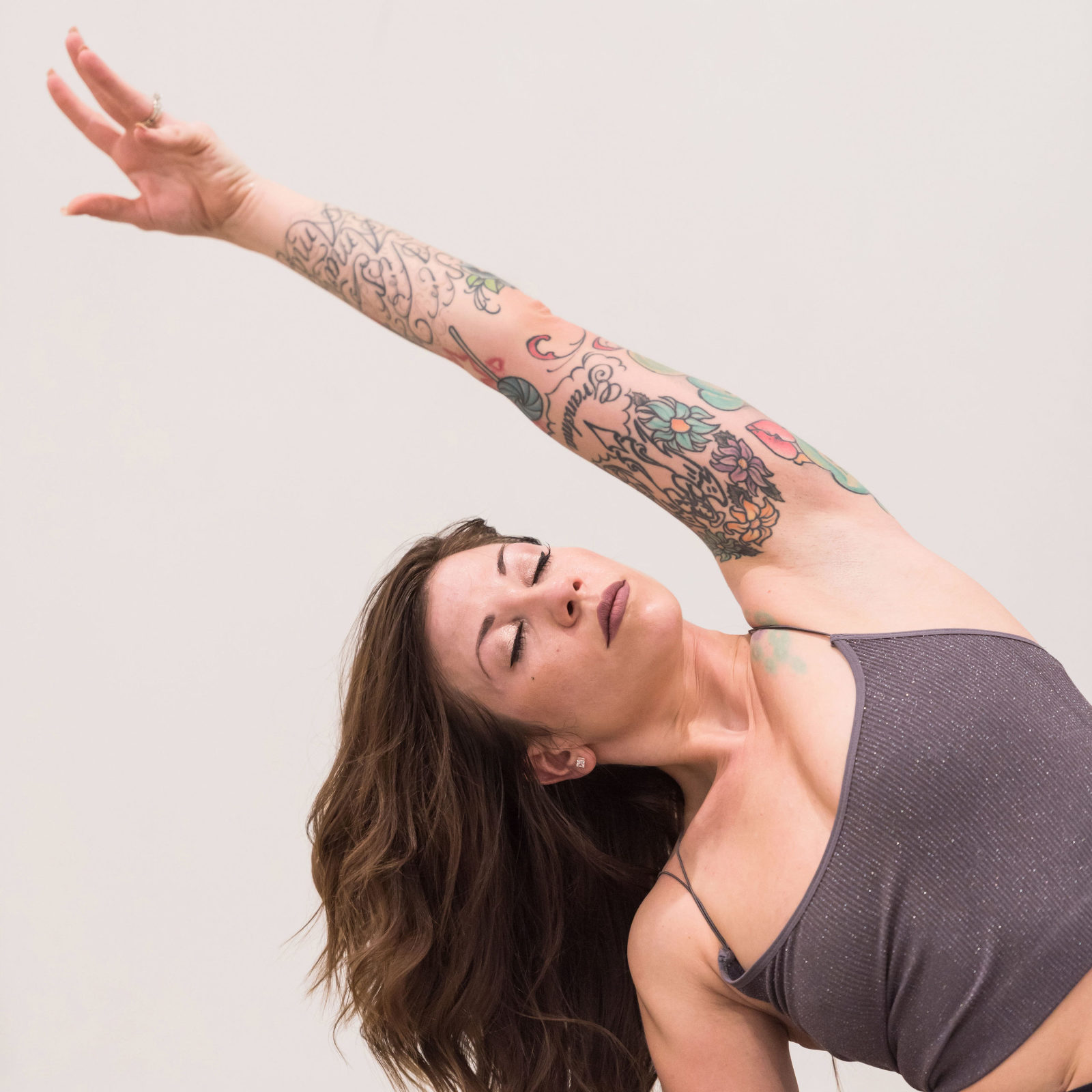 Brunette woman stretching for yoga pose during personal branding session at Fusion Yoga in Fort Wayne, Indiana
