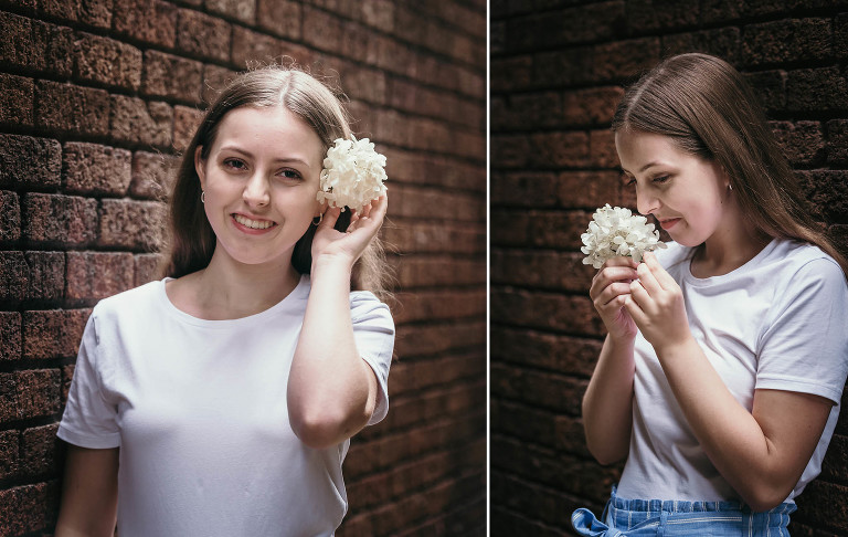 Diptych of brunette teenage girl in white shirt holding white flowers by brick wall in downtown Fort Wayne, Indiana