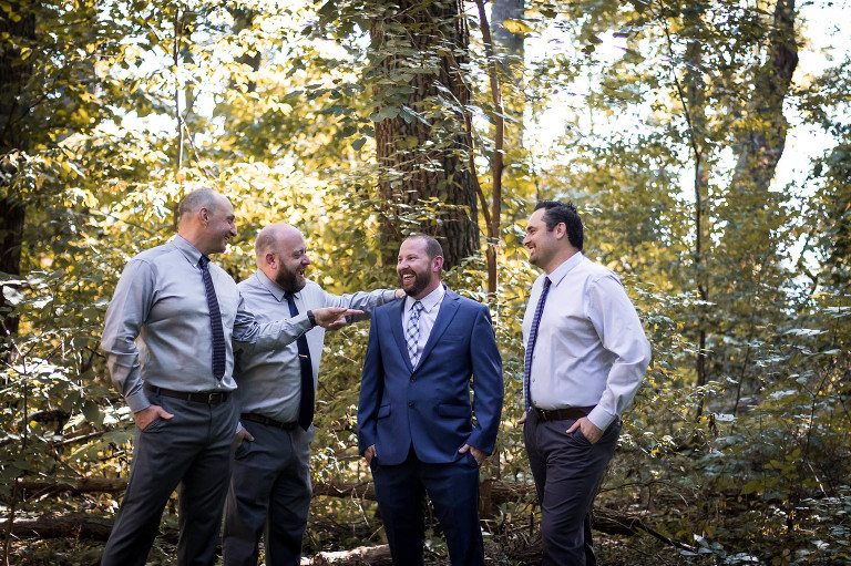 Groomsmen laughing with groom outdoors at Pokagon State Park wedding