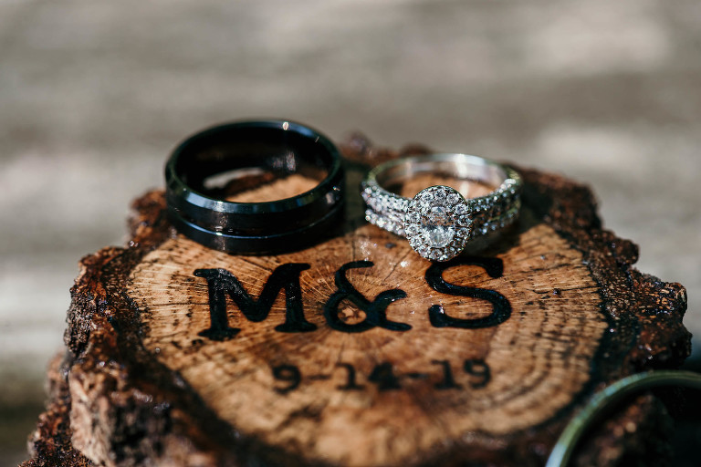 Close up of bride and groom rings during unique outdoor DIY wedding at Pokagon State Park