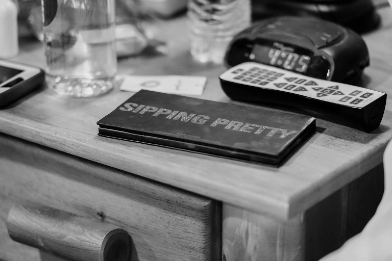 Black and white image of makeup palette during bridal prep at Pokagon State Park