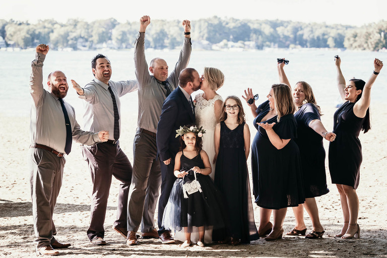 Bridal party cheering on beach at Pokagon State Park