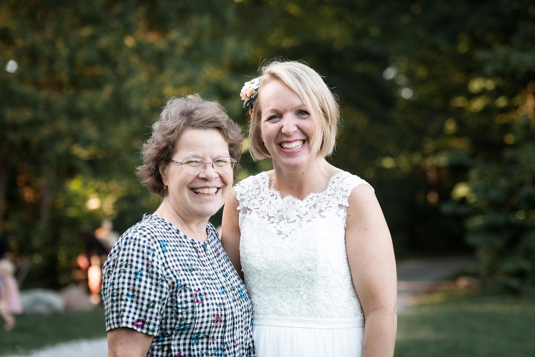 Bride posing with guest after outdoor wedding ceremony at Pokagon State Park
