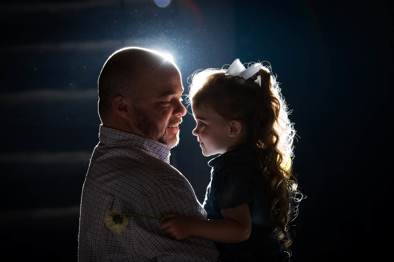 Father and young daughter dancing during wedding reception at CCC Shelter at Pokagon State Park