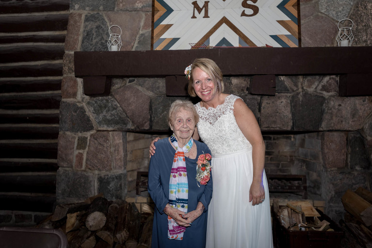 Bride posing with grandma in CCC Shelter at Pokagon State Park wedding
