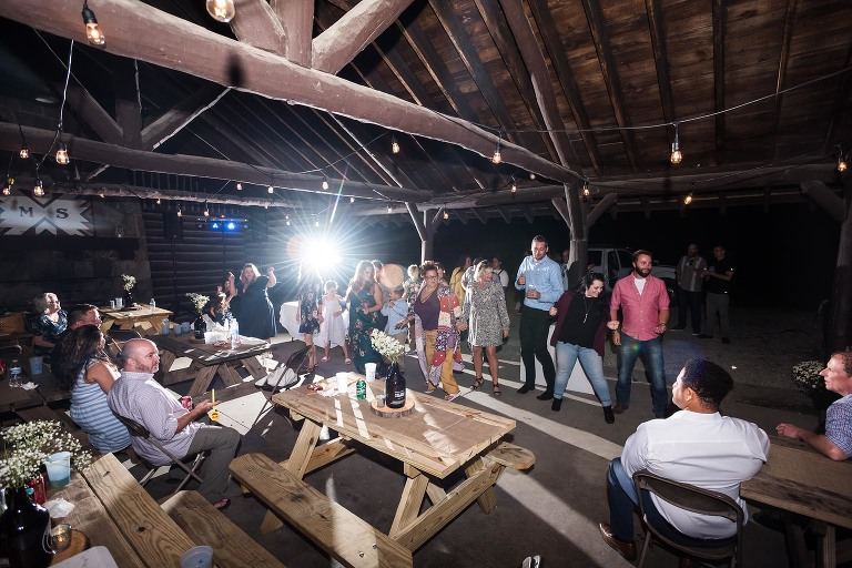 Wide angle image of guests dancing together during wedding reception at Pokagon State Park