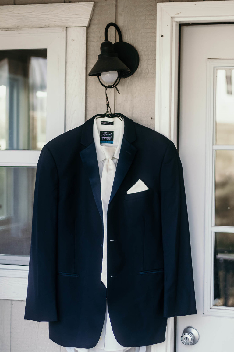Groom's suit hanging outside cabin during prep