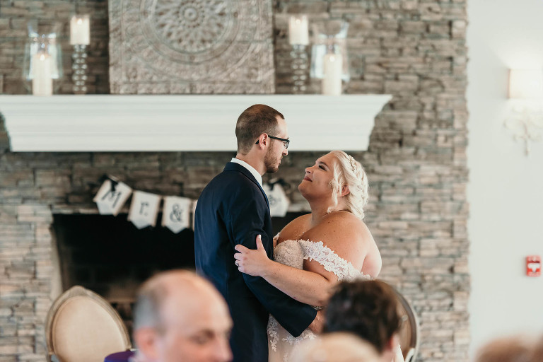 Bride and groom's first dance during reception at intimate fall wedding