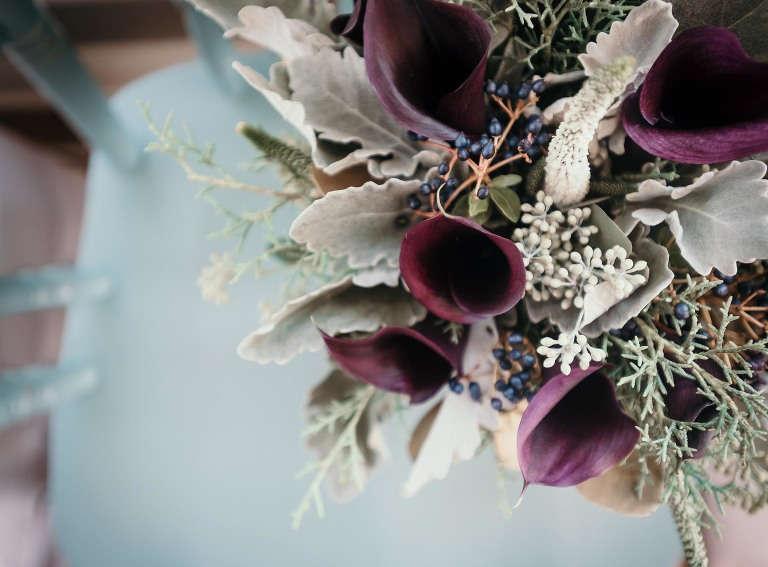 Closeup of purple calla lilies in fresh bridal bouquet