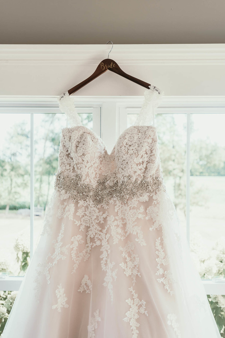 Lace wedding dress details on custom hanger